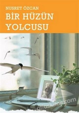 BİR HÜZÜN YOLCUSU (  )